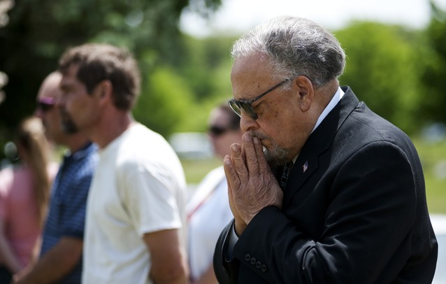 An audience member of the Arborcrest Memorial Day Observance participates in a prayer on Sunday, May 26. Daniel Brenner I AnnArbor.com