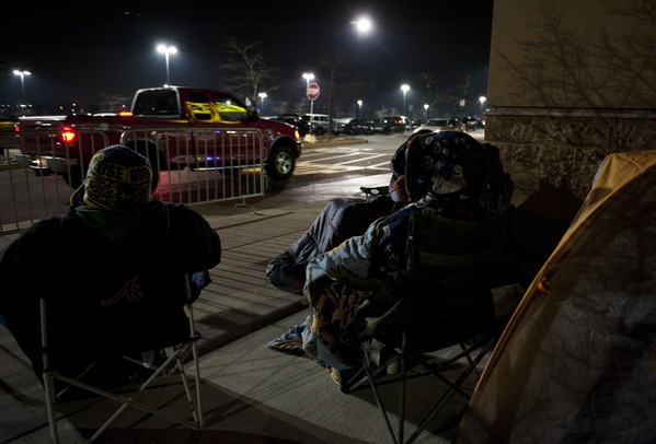 Customers wait in line for Black Friday deals outside Best Buy late Wednesday night. Best Buy will open Thursday at midnight. Daniel Brenner I AnnArbor.com