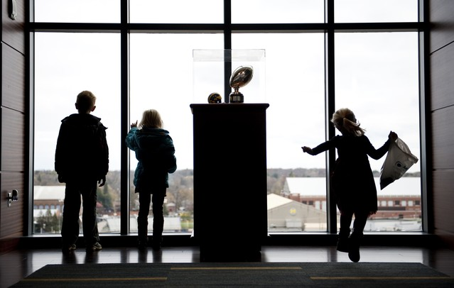 Youngsters look out a window on the club level during the Be a Hero at the Big House blood drive on Sunday. Daniel Brenner I AnnArbor.com