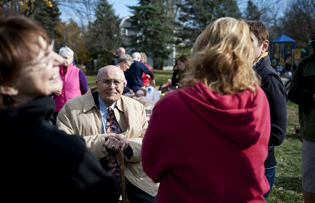 U.S. Rep. John Dingell, who is responsible for delivering nearly $14 million in federal funding for the Stadium bridges project, hangs out with residents of a nearby neighborhood gathered in Rose-White Park to celebrate the completion of the project on Sunday. Daniel Brenner I AnnArbor.com