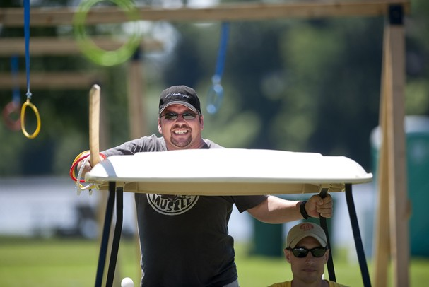 Taylor resident Paul Jesmantas attempts to collect rings using a pole while riding a golf cart at the Saline Celtic Festival on Saturday, July 13. Daniel Brenner I AnnArbor.com