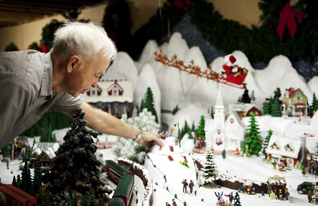 Saline resident Charles Elkins points out a detail in his North Pole display in his basement on Monday. Elkins has been working on these creations for ten years and this is his favorite display. Daniel Brenner I AnnArbor.com