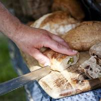 Samples of bread are cut during the Cobblestone Farm Farmers Market on Tuesday, May 21. Daniel Brenner I AnnArbor.com