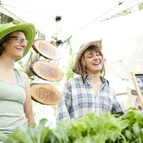 Green Things Farms co-owner Jill Lada and employee Sarah Alexander (left to right) sell merchandise during the Cobblestone Farm Farmers Market on Tuesday, May 21. Daniel Brenner I AnnArbor.com