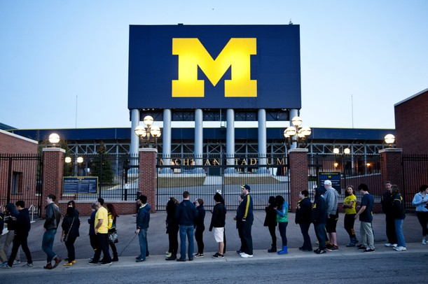 A long line to enter Crisler Arena for a watch party wraps around The Big House on Monday, April 8. Daniel Brenner I AnnArbor.com
