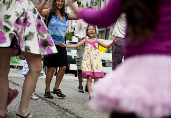 Charlotte Hildebrandt, six, learns Anglo-American dance with her family and others at the Dancing in the Streets Festival on Sunday. Daniel Brenner I AnnArbor.com