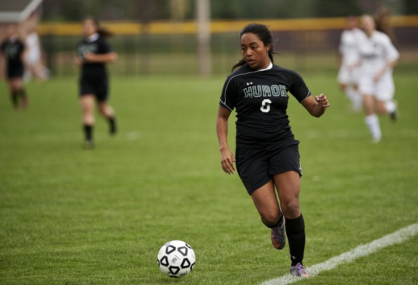 Huron High School senior Ify Odum handles the ball up the sideline in the game against Dexter on Tuesday, April 23. They tied 1-1. Daniel Brenner I AnnArbor.com