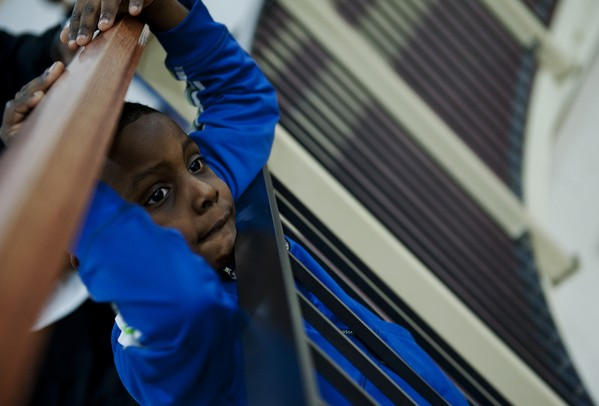 Ypsilanti High School fan and five-year-old Tonio Toliver watches the junior varsity game on Friday, Feb. 15. Daniel Brenner I AnnArbor.com