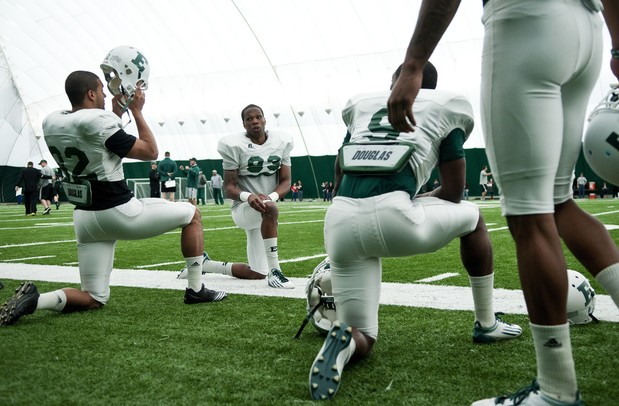 EMU players stretch before the spring practice on Sunday, April 14. AnnArbor.com I Daniel Brenner