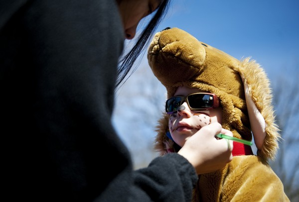 Ann Arbor resident Adreas Welsh, 4, gets his face painted at the Ann Arbor Co-op Housing tent during Earth Day at the Leslie Science and Nature Center on Sunday, April 21. AnnArbor.com I Daniel Brenner
