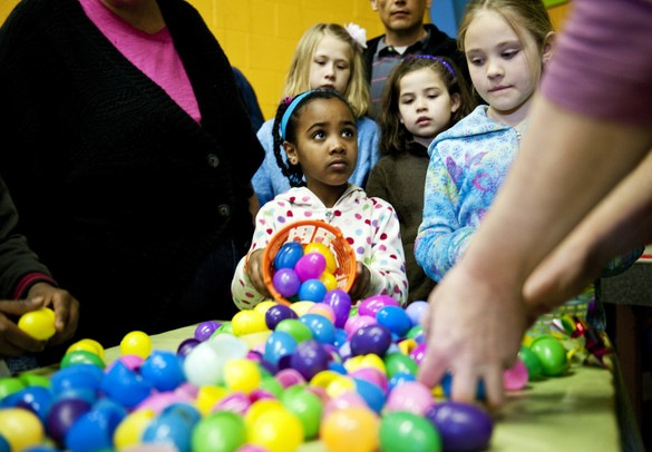 Burns Park resident Maia Rivette, seven, dumps out collected eggs at the Easter Egg Hunt and Breakfast at Ann Arbor Vineyard Church on Saturday, March 30. Daniel Brenner I AnnArbor.com