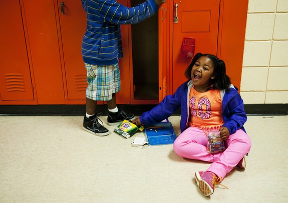 Estabrook Elementary School second-grader Amya Reeves cleanes out her locker on the last day of school on Friday, June 7. Daniel Brenner I AnnArbor.com