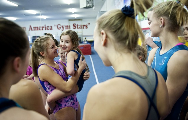 Six-year-old Faith Falzon plays and talks with the level nine gymnastics team on Monday, Jan. 28. Faith has a rare, incurable bowel disorder which forces her to spend most days in the hospital. Daniel Brenner I AnnArbor.com