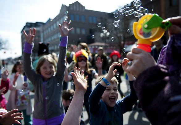 Kids enjoy bubbles before the Festifools street party on Main Street on Sunday, April 7. Daniel Brenner I AnnArbor.com