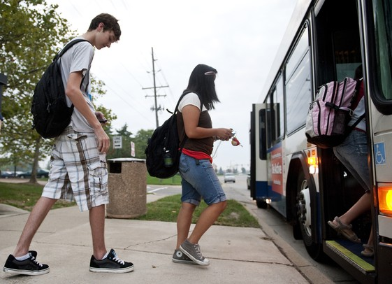 Pioneer junior James Sazyc and others board a bus on the new Ann Arbor Transportation Authority bus route on Waters Road on Tuesday. Daniel Brenner I AnnArbor.com