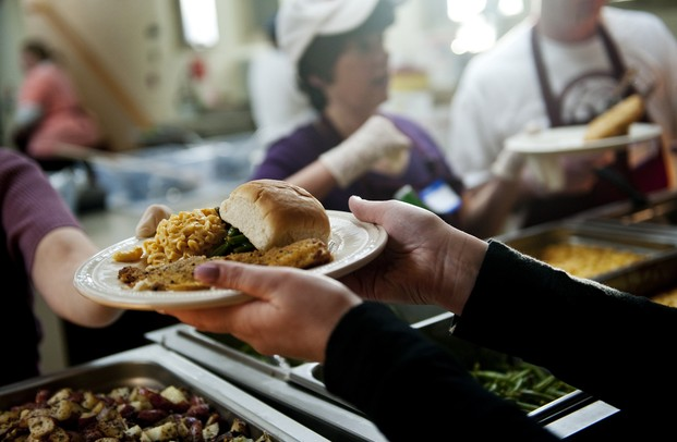 Food is handed out on sustainable plates at St. Frances Church on Friday, March 8. Daniel Brenner I AnnArbor.com