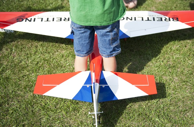 Eoin Hubbard, 8, stands over a remote control airplane at the 29th Flying Pilgrims Radio Control Club event on Sunday. Daniel Brenner I AnnArbor.com