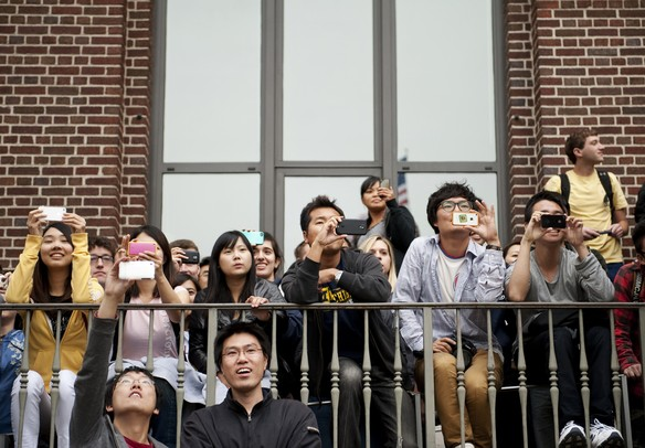 An audience gathers at the diag on Michigan campus to witness a Gangnam style flash mob on Friday. Daniel Brenner I AnnArbor.com