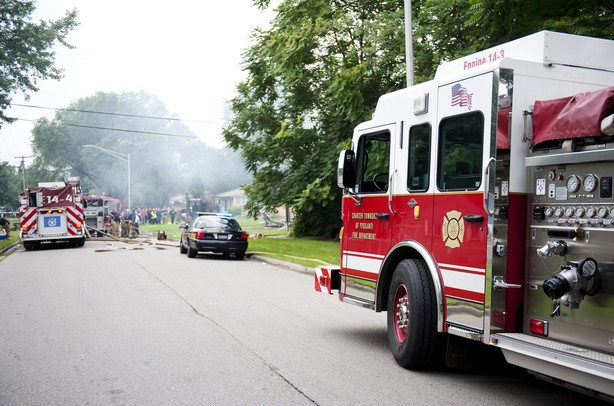 Emergency vehicles respond to the scene of an explosion at a house near the intersection of Gattegno and Foley in Ypsilanti Township on Sunday, July 7. Daniel Brenner I AnnArbor.com