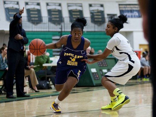 Ypsilanti High School senior Jasmine Jones drives against a Huron defender in the game on Monday, Feb. 25. Daniel Brenner I AnnArbor.com