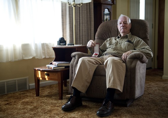 World War II veteran Glenn Dickerson sits in his living room on Monday. Dickerson is being honored with the Knight of the Legion of Honor award for his efforts in the liberating of France. Daniel Brenner I AnnArbor.com