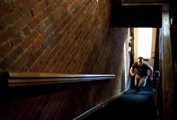 Grange server Matt Yost runs up the stairs before the restaurant opens on Friday, Jan. 4. Yost has been a server for 15 years and has worked at Grange for about a year. Daniel Brenner I AnnArbor.com