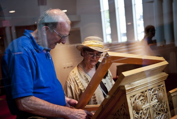 Chairman of tour guides Mike Kapetan and Ann Arbor resident Zora Singer inspect and discuss an icon inside the St. Nicholas Greek Orthodox Church during the Ya'ssoo Greek Festival on Friday, May 31. Daniel Brenner I AnnArbor.com