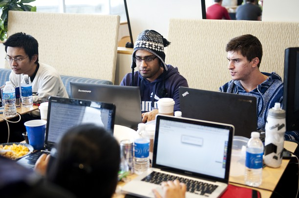 Penn. graduate student Rajib Dutta works with other students in Palmer Commons during the Hackathon part one on Saturday, Feb. 2. Daniel Brenner I AnnArbor.com