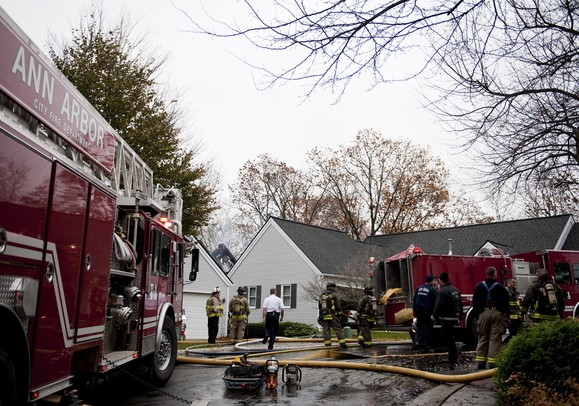 Firefighers resound to the scene on Heritage Drive in Ann Arbor on Tuesday. Fire Chief Chuck Hubbard says they extinguished the fire in 30 minutes, but the interior of the structure is completely burnt. He was unable to determine the cause of that fire at the time. Daniel Brenner I AnnArbor.com