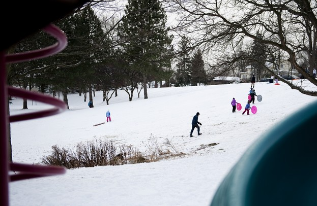 Sledders climb the hill near a playground at Hunt Park in Ann Arbor on Friday, Dec. 28. Daniel Brenner I AnnArbor.com