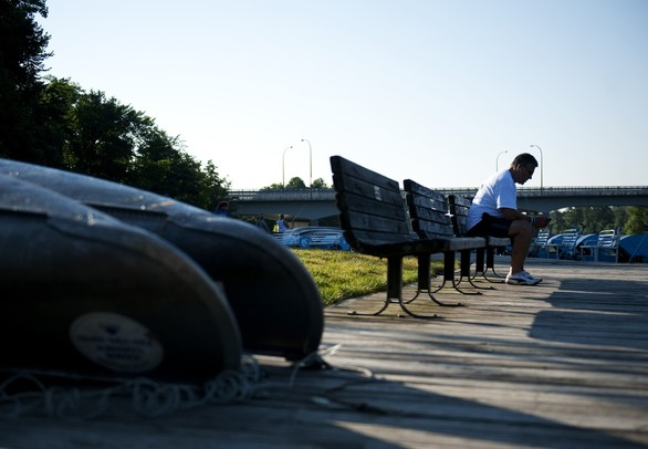 Livonia resident Horia Tugulan listens to music on the dock before participating in the Gallup Gallop 5k run/fitness walk during Huron River Day on Sunday, July 14. Daniel Brenner I AnnArbor.com