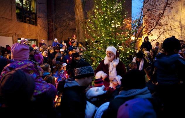 A crowd gathers in Kerrytown to witness the holiday tree lighting on Sunday. Santa said this was the biggest audience he has seen in the last few years. Daniel Brenner I AnnArbor.com