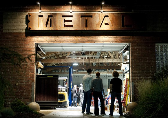 An audience gathers at METAL at 220 Felch Street to listen to music Sunday night. The space doubles as a design fabrication shop and gallery by day and a concert venue a couple nights a month. The business opened in April 2011. Daniel Brenner I AnnArbor.com