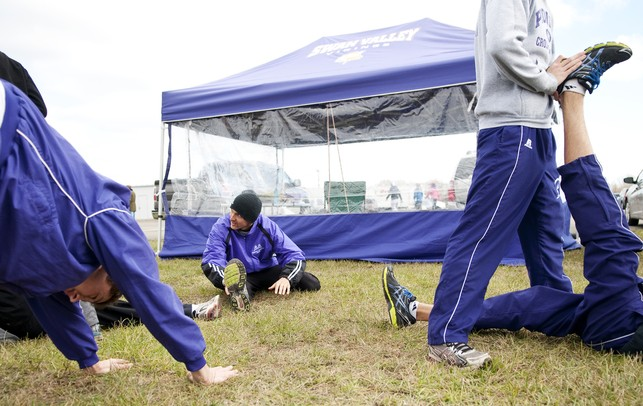 The Ann Arbor Pioneer HIgh School cross country team stretches before their race on Saturday. They finished fifth in the MHSAA Division One race. Daniel Brenner I AnnArbor.com