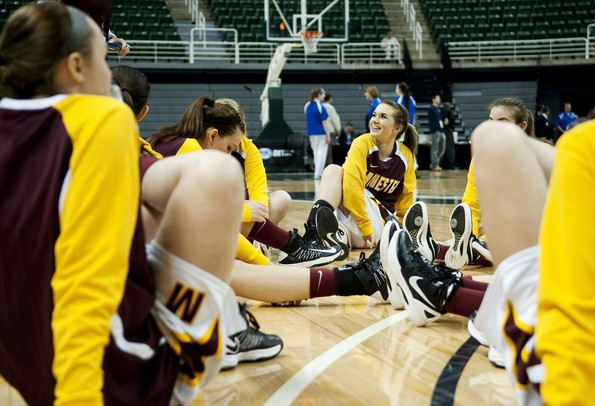 The Manchester girls basketball game stretches before the game against Saginaw Nouvel on Saturday, March 16. Daniel Brenner I AnnArbor.com
