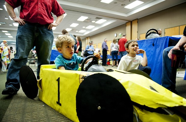 Ann Arbor resident Daniel Pritts, 4, plays in a race car game cockpit during the Mini Maker Faire on Saturday, June 8. Daniel Brenner I AnnArbor.com