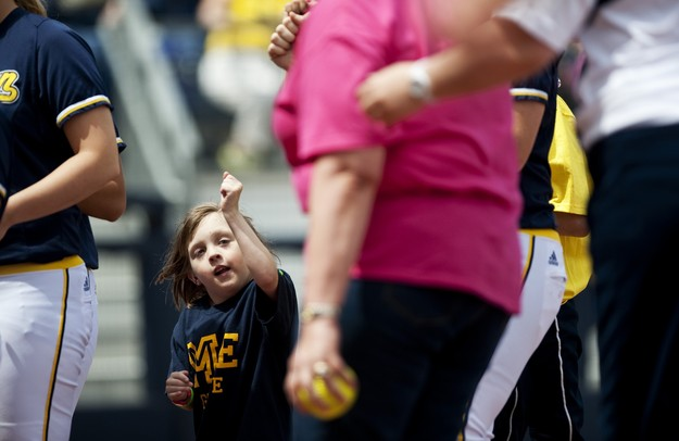 Natalie Harper pumps her fist in the air after the first pitch of the softball game on Saturday, May 4. Daniel Brenner I AnnArbor.com