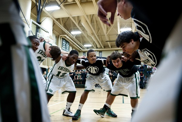 The Father Gabriel Richard HIgh School basketball team rallies together before the start of the game against Ann Arbor Pioneer on Tuesday. Daniel Brenner I AnnArbor.com