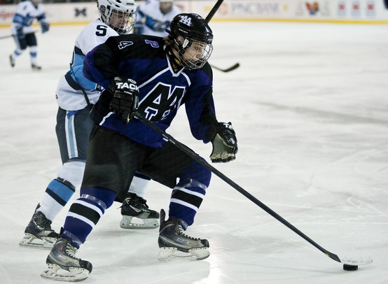 Pioneer High School sophomore Jason Maezes handles the puck in the game against Livonia Stevenson on Tuesday, March 5. Pioneer lost in double overtime 3-2. Daniel Brenner I AnnArbor.com