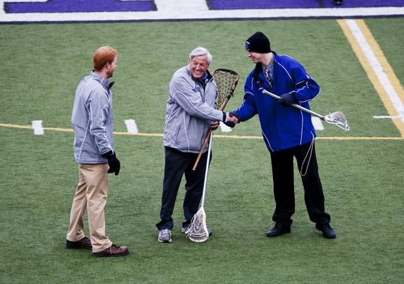 "Head coaches  Jack Robenalt and Smith Altwood shake hands before the game on Friday, April 12. Skyline consultant Dr. James ""Gil"" Leaf presented the teams with a Native America lacrosse stick that will act as a traveling trophy for the two teams. AnnArbor.com I Daniel Brenner"