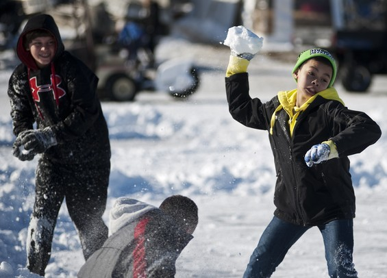 Whitmore Lake resident Keagan Logan, 12, and friends have a snowball fight on Saturday, Feb. 9. Daniel Brenner I AnnArbor.com