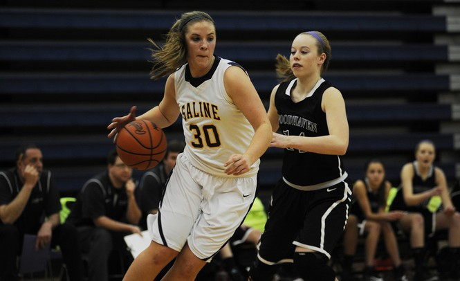 Saline High School senior Caitlin Ellis dribbles in the game against Woodhaven on Tuesday, March 5. Daniel Brenner I AnnArbor.com