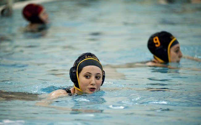 Saline water polo players line up before the start of the second half of the game against Grand Haven during the Hornet Invite on Friday, April 19. AnnArbor.com I Daniel Brenner