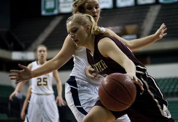 Dexter HIgh School sophomore Crystal Kedroske dribbles toward the rim in the game against Saline at the EMU Convocation Center on Friday Jan. 4. Daniel Brenner I AnnArbor.com