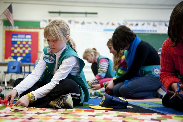 "Fifth-grade student and girl scout Abby Warrick works on a blanket to send to the New Hope Baptist Church in Newark, New Jersey on Tuesday, Jan. 22. Abby came up with the idea while watching the news. ""I wanted people who don't have homes to have a blanket to stay warm during the winter,"" she says. Daniel Brenner I AnnArbor.com"