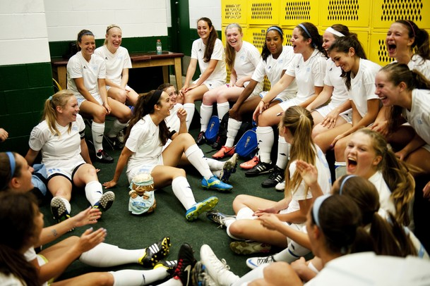 The Skyline High School soccer team laughs in the locker room during the first weather delay of the game against Huron on Thursday, May 30. Daniel Brenner I AnnArbor.com
