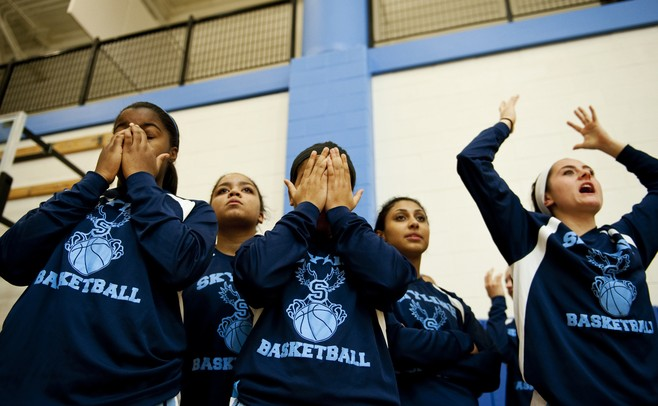 The Skyline High School girls varsity basketball team reacts to the conclusion of the junior varsity game on Friday. Daniel Brenner I AnnArbor.com
