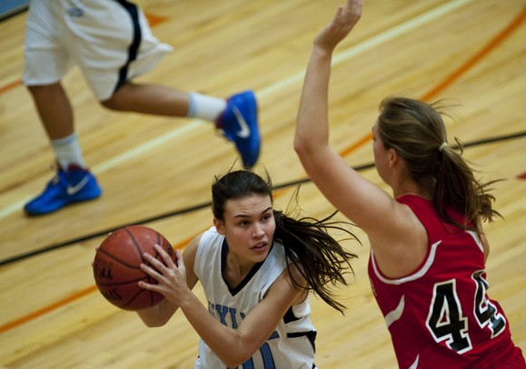 Skyline High School senior Tori Norris looks to pass in the first quarter against Whitmore Lake on Friday. Skyline won 55-32. Daniel Brenner I AnnArbor.com