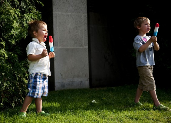 Saline residents Sabastian, 2, and Julien, 4, Polidano eat bomb pops on the last day of the Ann Arbor Sumer Festival on Sunday, July 7. Daniel Brenner I AnnArbor.com