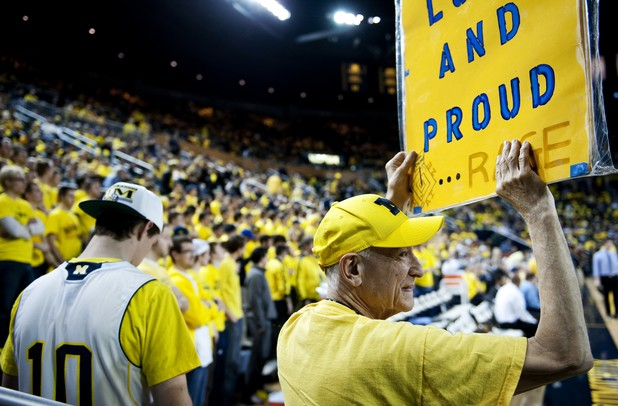 "Michigan fan and Canton resident ""True Blue"" Tom Malden holds a sign before the game against Michigan State on Sunday, Mar. 3. Daniel Brenner I AnnArbor.com"